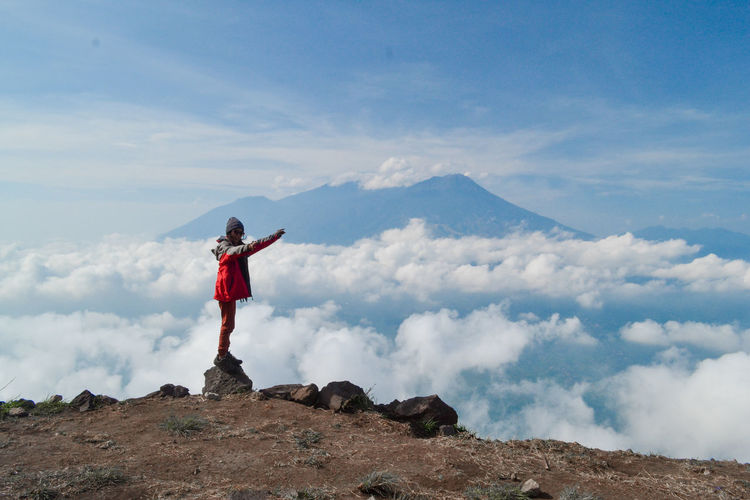 One Person Standing Sky Cloud - Sky Leisure Activity Scenics - Nature Lifestyles Mountain Rock Rock - Object Beauty In Nature Full Length Real People Solid Human Arm Casual Clothing Tranquil Scene Tranquility Vacations Nature Mountain Range Outdoors Arms Raised Mountain Peak
