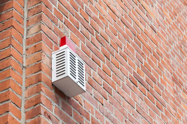 Alarm system on a brick wall