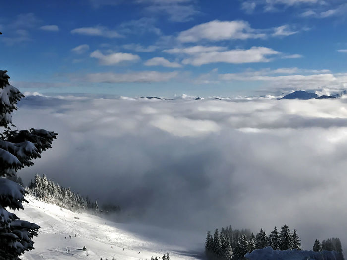 scenic view of snow capped mountains over heaven Heaven Perspectives On Nature Beauty In Nature Cloud - Sky Cold Temperature Day Departure Fog Landscape Mountain Nature No People Outdoors Scenics Skier Sky Slope Snow Snowcapped Mountain Sunlight Tranquil Scene Tranquility Tree Weather Winter