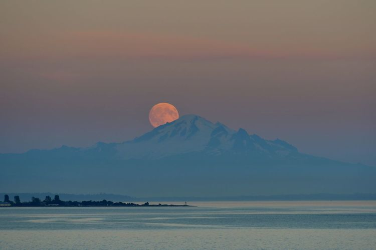 Moon with mountain in foreground