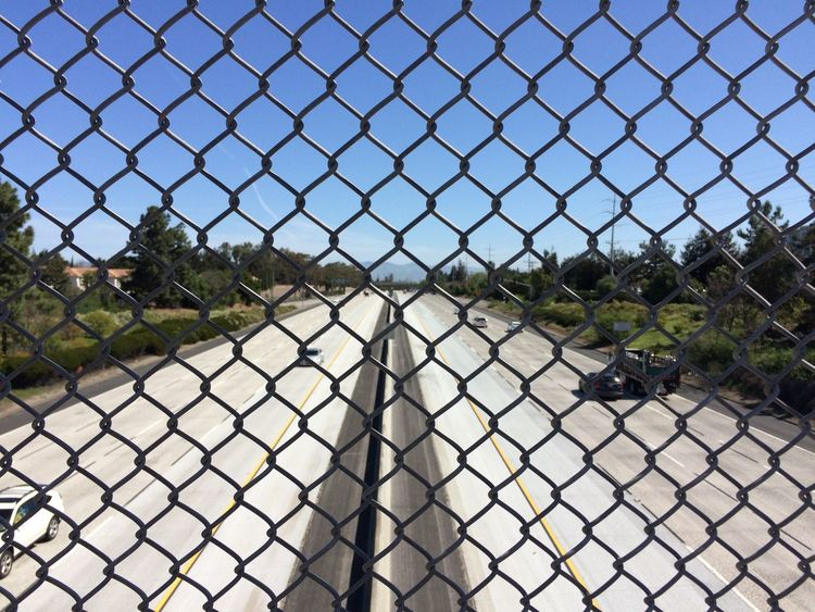 Cars Day Fence Highway Sky Sunlight