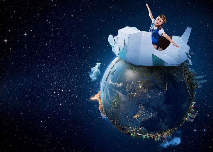 Digital composite image of girl sitting in toy airplane over earth