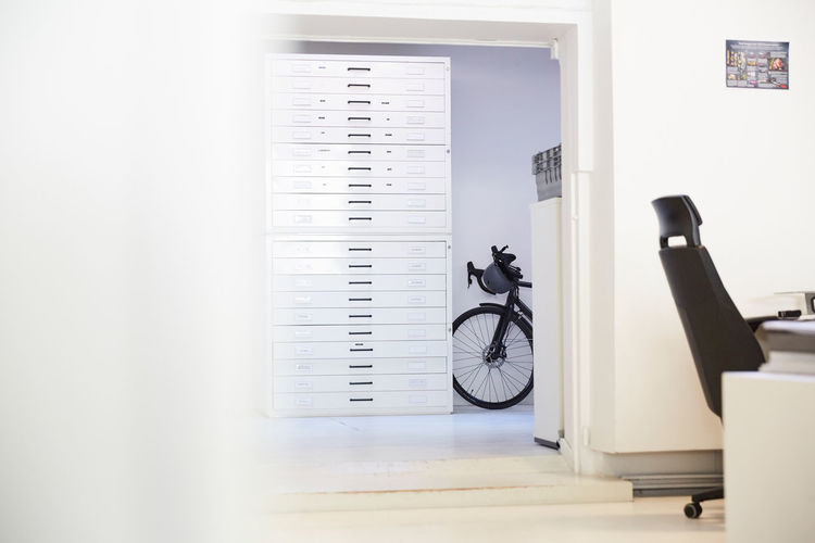 Bicycle on table by wall at home