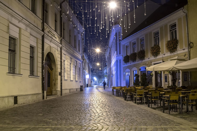 Midnight Stroll Architecture Building Exterior Built Structure Street City Illuminated Building Night Street Light Lighting Equipment Residential District The Way Forward Direction No People Empty Cobblestone Footpath Outdoors Seat Alley Midnight Walking City Street Light
