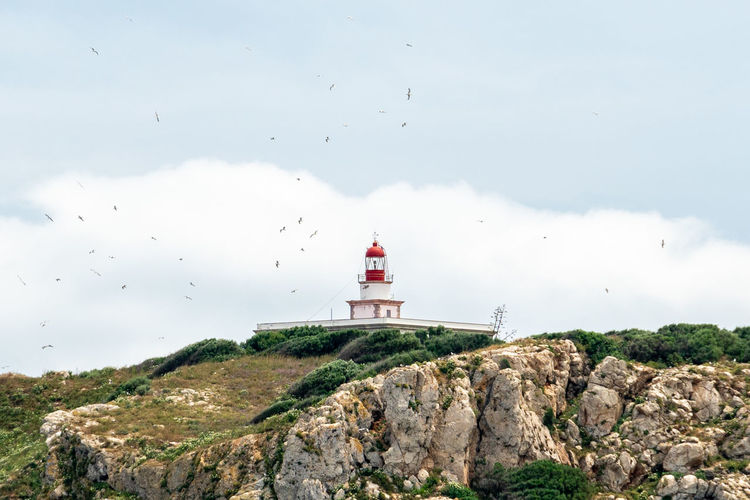 Architecture Building Building Exterior Built Structure Cloud - Sky Day Direction Guidance Lighthouse Mountain Nature No People Outdoors Protection Rock Rock - Object Security Sky Solid Tower Travel Destinations