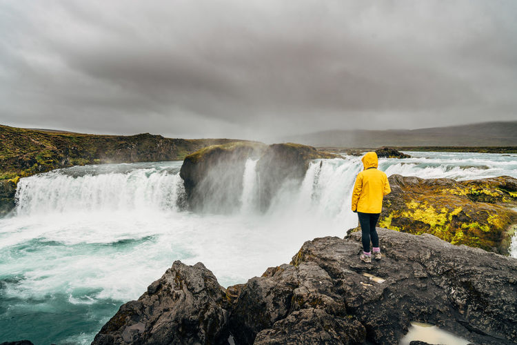 Adults Only Adventure Authority Awe Beauty In Nature Cloud - Sky Dramatic Landscape Dramatic Sky Hiking Iceland Landscape Long Exposure Nature One Person One Woman Only Only Women Outdoors Overcast Rear View Scenics Storm Cloud Travel Destinations Water Waterfall Lost In The Landscape