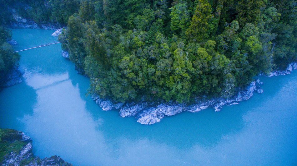 blue lake shot by drone in new zealand Drone  Aboutpassion Aerialphotography Beauty In Nature Blue Day Green Color Growth High Angle View Idyllic Nature No People Outdoors Plant Reflection Scenics - Nature Sea Swimming Pool Tranquil Scene Tranquility Tree Turquoise Colored Vanlife Water Waterfront