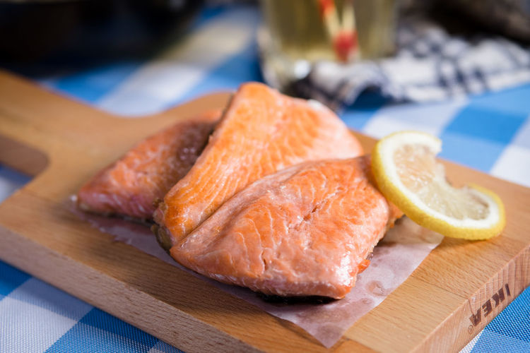 Fresh Salmon Seafood Citrus Fruit Close-up Cutting Board Focus On Foreground Food Food And Drink Fresh Freshness Fruit Healthy Eating Indoors  Japanese Food Kitchen Knife No People Ready-to-eat Salmon Serving Size SLICE Still Life Table Wellbeing Wood - Material
