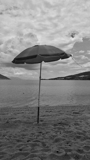 Man EyeEm Black And White Blackandwhite Photography Beautiful Nature Water Beach Sea Sand Summer Protection Sky Cloud - Sky Beach Umbrella Sunshade Umbrella Under Shelter