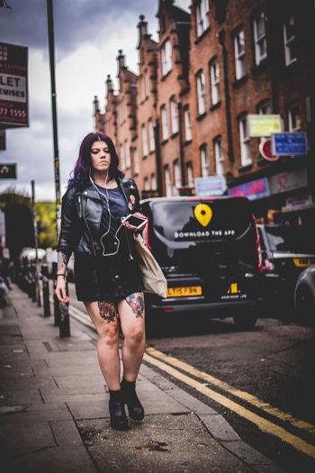 Full length of woman standing on city street
