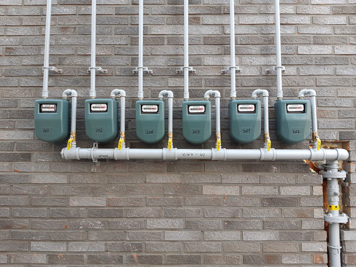 Outdoors Meter - Instrument Of Measurement In A Row Pipe - Tube Built Structure Fuel And Power Generation Brick Wall Wall Brick Wall - Building Feature Gas Meter