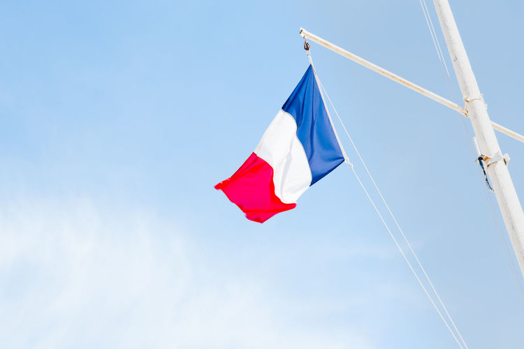 Blue Boat Clear Sky Copy Space Day Emotion Flag French Flag Low Angle View National Icon Nature Nautical Vessel No People Outdoors Patriotism Pole Pride Red Sky Summer White Color Wind