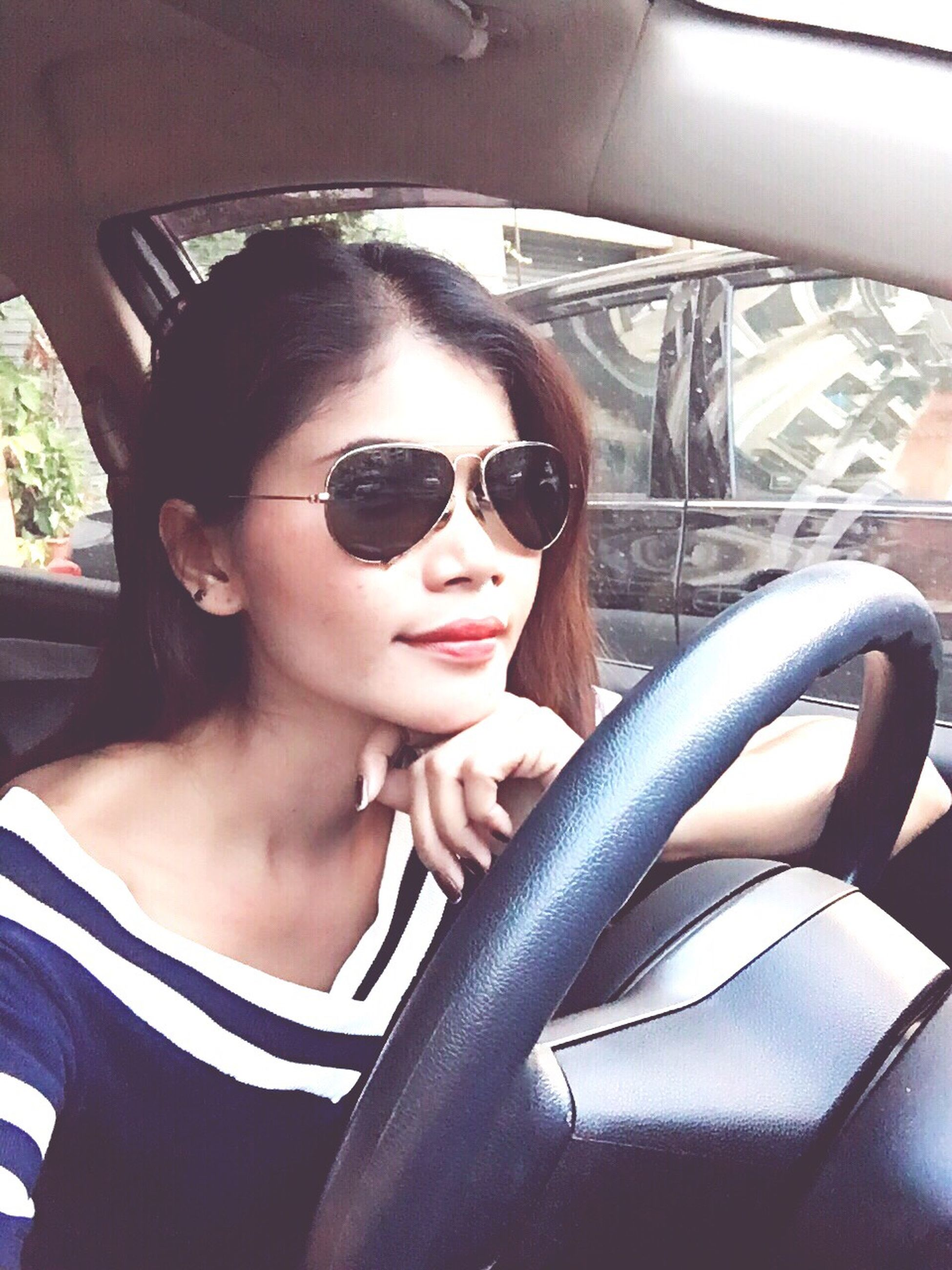 transportation, mode of transport, land vehicle, car, vehicle interior, sunglasses, young adult, looking at camera, portrait, car interior, person, lifestyles, leisure activity, travel, close-up, front view, young women, headshot