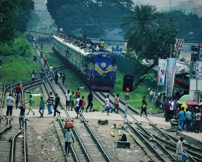 High Angle View Of People On Railroad Tracks