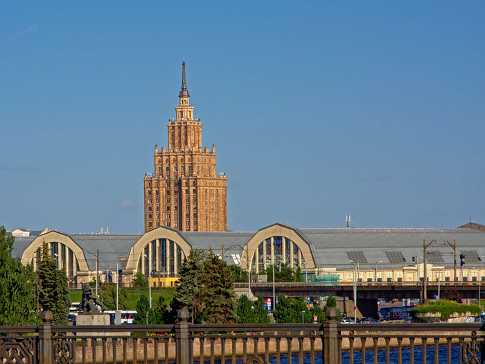 Tower of te Latvian academy of sciences with central market hall in front, Riga, on a sunny day Architecture Market Soviet Union Academyofart Architecture Building Building Exterior Built Structure City Clear Sky Monument Riga Sciences Po Skyscraper Soviet Soviet Architecture Tourism Tower Travel Travel Destinations University Student