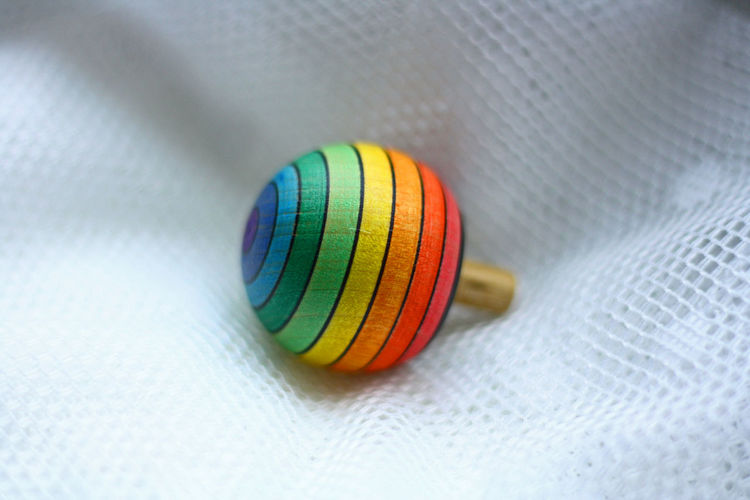 High angle view of colorful toy on fabric
