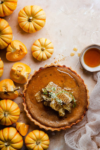 High angle view of pumpkin pie served on table