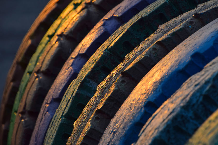 Colorful vivid vibrand painted wheel tires in golden evening light Abstract Art Bold Close-up Colorful Colors Decoration Design Exterior Geometric Shape Industrial Modern Painted Pattern Perspective Playground Texture Tire Tires Tread Tyre Vibrant Vivid Wheels Pivotal Ideas