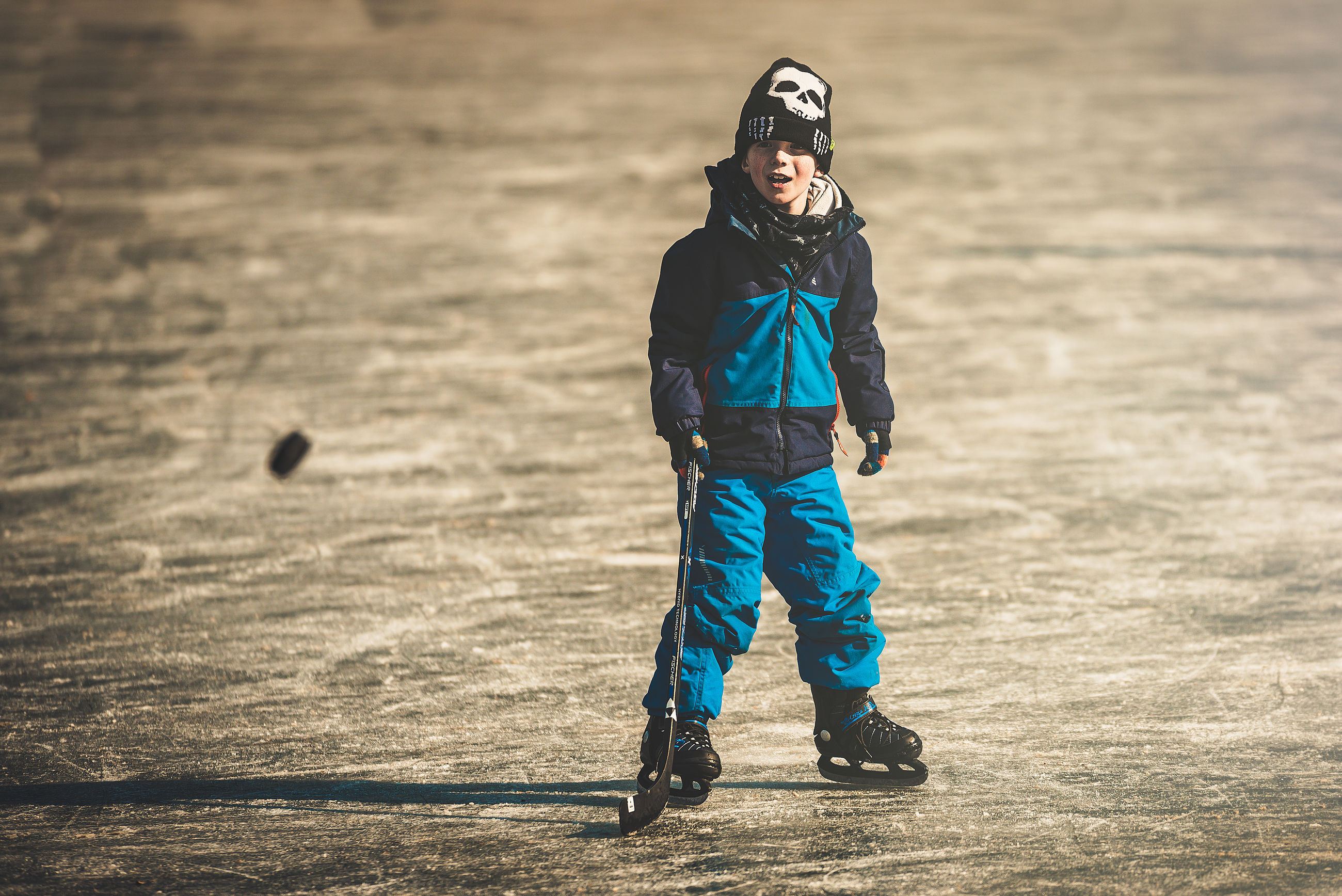 one person, full length, real people, leisure activity, clothing, focus on foreground, standing, nature, childhood, males, front view, day, lifestyles, men, land, child, outdoors, field, winter, warm clothing, hood - clothing
