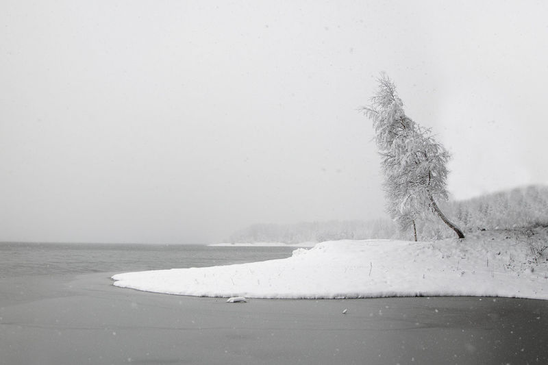 Scenic view of sea against clear sky during winter