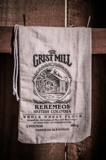 Keremeos, British Columbia/Canada - June 3, 2017: a flour sack in the grist mill at The Grist Mill and Gardens Keremeos, an important historic site dating to 1877. 1800's 1877 British Columbia, Canada Nails Similkameen Valley The Grist Mill And Gardens Keremeos Travel Wall Aged Close-up Cloth Sack Editorial  Flour Mill Flour Sack Grist Mill Historic History Keremeos Museum Nailed Texture Tourism Tours Vintage Wooden