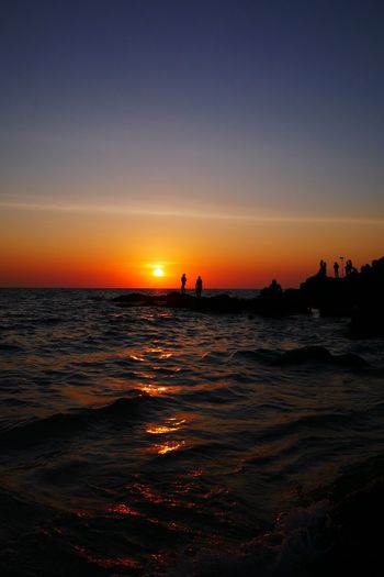The evening sun before sunset Sky Sea Water Sunset Beauty In Nature Scenics - Nature Horizon Wave Sun Outdoors Orange Color Waterfront