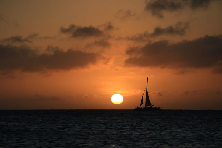Beauty In Nature Cloud - Sky Horizon Over Water Idyllic Nature Nautical Vessel No People Outdoors Sailboat Sailing Sailing Ship Scenics Sea Silhouette Sky Sun Sunset Tranquil Scene Tranquility Travel Destinations Water Aruba Yacht Beach Orange Color