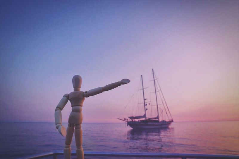 Hey, look up there! Water Sea Nautical Vessel Clear Sky Sunset Sky Scenics Horizon Over Water Outdoors Waterfront One Person Nature Men Lifestyles Real People Full Length Beauty In Nature Yachting Montenegro Woodyforest