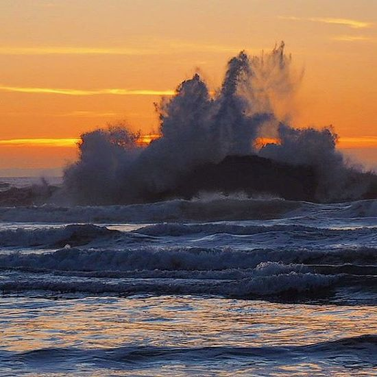 A Wave crashes into an offshore Rock throwing a huge Splash into the Sunset ... Getolympus Olympusomdem1 Omdem1 Zuikodigital Pacificnorthwest Pacificnw PNW PNWonderland Pnwlife Iloveoregon TravelOregon Upperleftusa Ocean Waves Orange