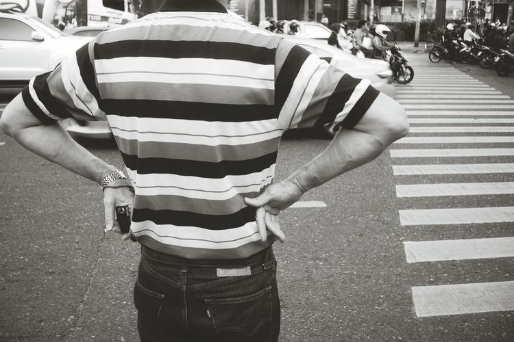 Midsection of man standing on road