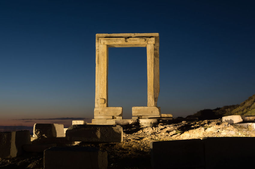 The remains of the ancient temple of Delian Apollo, also called Portara, at dusk, at Naxos island, Greece Aegean Sea Gate Mediterranean  Ruins Ancient Apollo Arch Architecture Columns Cyclades Dusk Europe Gateaway Idyllic Island Landmark Monument Picturesque Portara Sanctuary  Scenery Sunset Temple The Past Travel Destinations