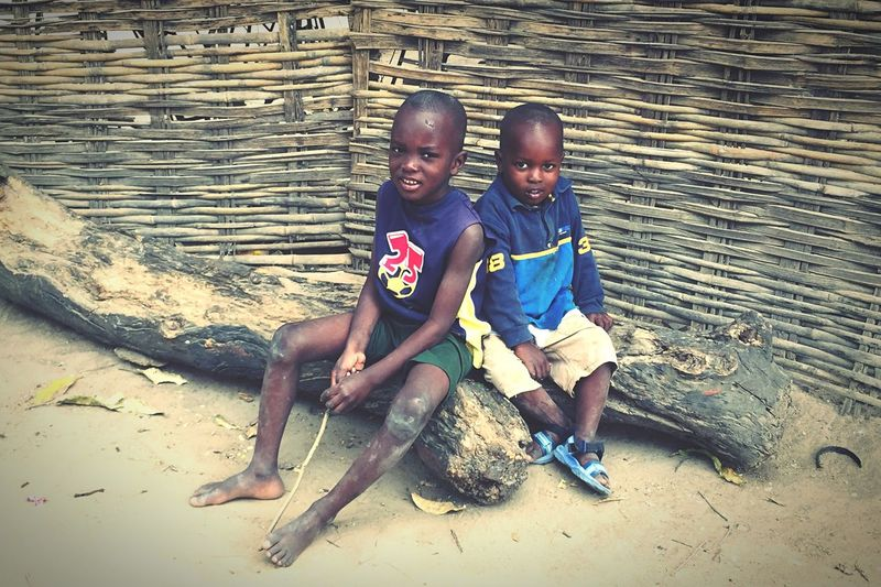 These two brothers asked us to take a picture of them as we were leaving my aunt's house located in the Santhiaba neighborhood of Ziguinchor. The Traveler - 2015 EyeEm Awards EyeEm Best Shots Mobilephotography Showcase:December Africa Day To Day Discover Your City Countryside IPhoneography Streetphotography Street Portrait Brotherhood