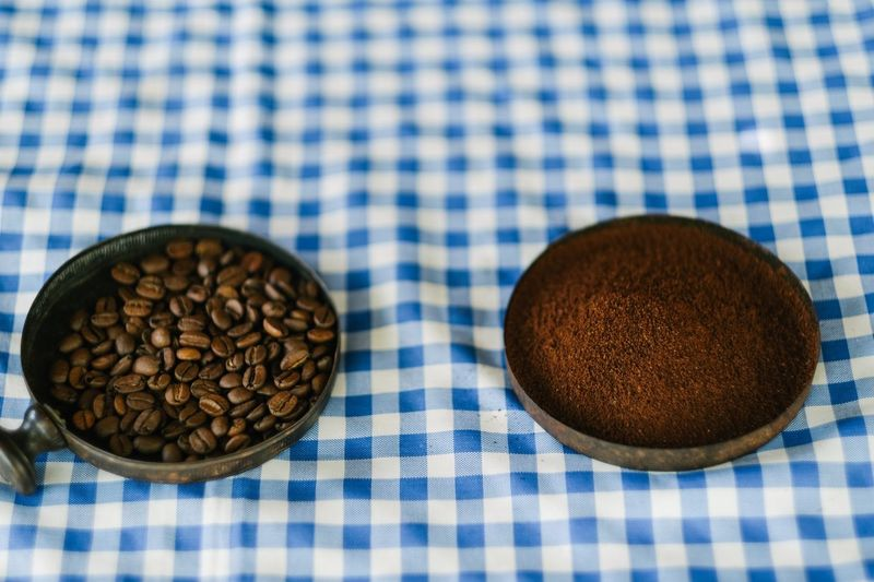Roasted coffee after being ground Coffee Beans Coffee Farm Brazilian Coffee Coffee Bean Coffee ☕ Coffee Food And Drink Food No People Tablecloth Checked Pattern Brown Indoors  Freshness Close-up Still Life Table High Angle View Blue Pattern Textile Healthy Eating Directly Above