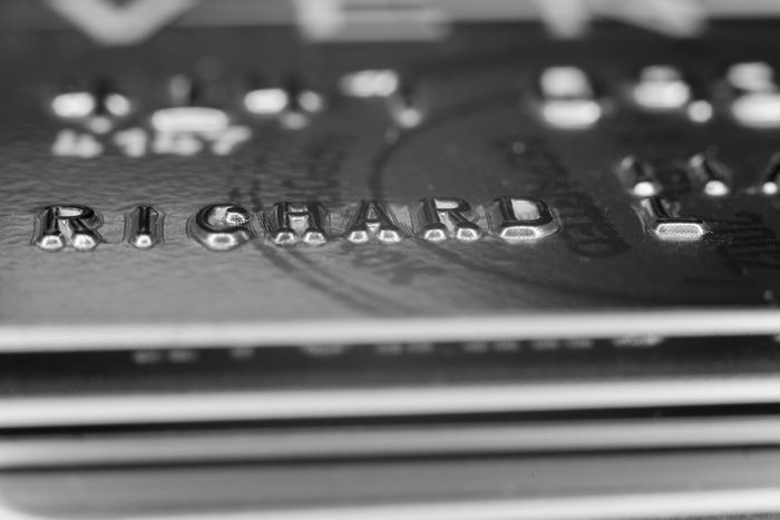 Stacked macro Credit Cards Black and White Banking Banking Business Buying Cash Close Up Commerce Credit Cards Crime Cyber Debt Firewall Fraud Identity Industry Macro Microchip Money Numbers Online  Shopping Spending Spending Money Tech Technology Theft