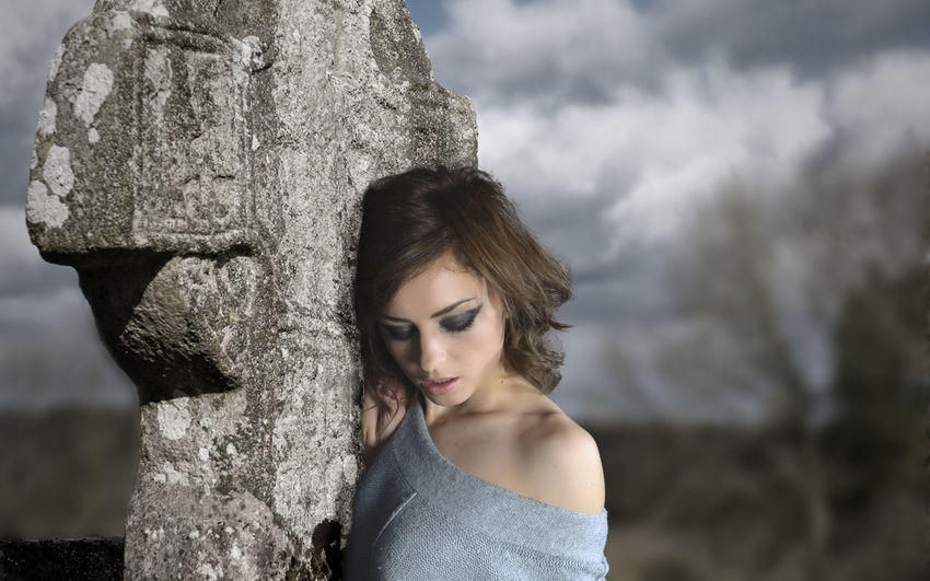The girl at the celtic cross Beauty Celtic Cross Close-up Cloud - Sky Contemplative Day Female Model Focus On Foreground Graveyard Headshot Human Face Ireland Irish Leisure Activity Lifestyles Outdoors Person Young Adult Young Woman Young Women