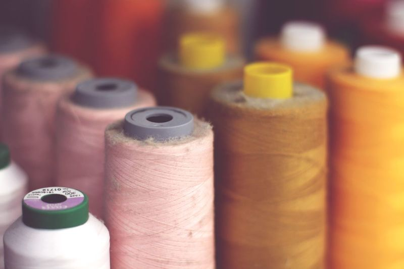 Close-Up Of Colorful Spools For Sale In Store