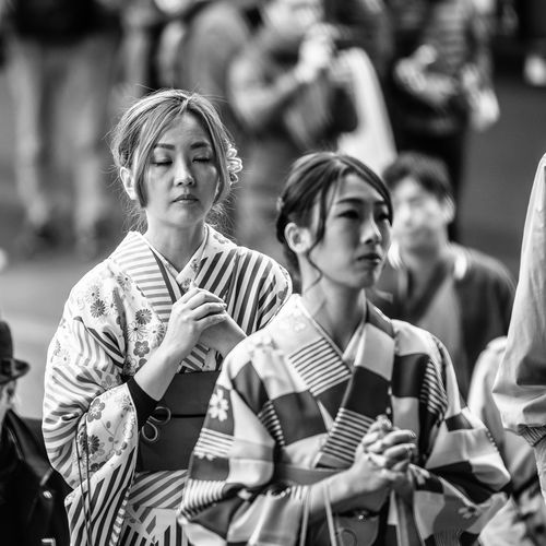 """""""Praying"""" Real People People Waist Up Focus On Foreground Incidental People Lifestyles Front View Casual Clothing Standing Group Of People Holding Day Women Striped Looking Clothing Young Adult Arts Culture And Entertainment Selective Focus Teenager The Art Of Street Photography My Best Photo"""