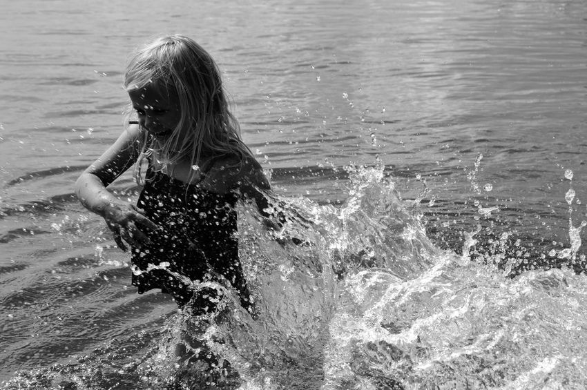 Summer in the sea Beauty In Nature Girl Summer Blackandwhite Black And White Water Lifestyles Real People Leisure Activity One Person Sea Child Nature Splashing Girls Day Childhood Motion Beach Enjoyment Sunlight Outdoors Pre-adolescent Child The Great Outdoors - 2018 EyeEm Awards The Portraitist - 2018 EyeEm Awards