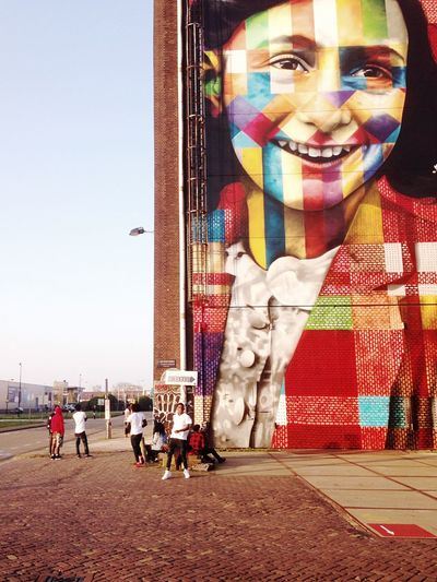 Anne Frank by Eduardo Kobra Amsterdam - Real People Built Structure Building Exterior Architecture Lifestyles Leisure Activity Outdoors Day Large Group Of People Sky City Adult People Streetphotography Streetart Streetart/graffiti Gang Murales StreetArtEverywhere