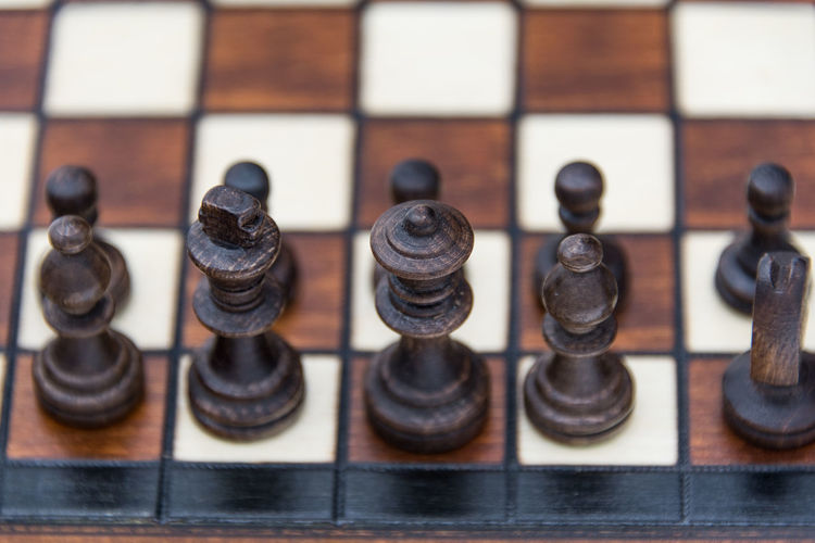 Close-up of chess pieces on white background