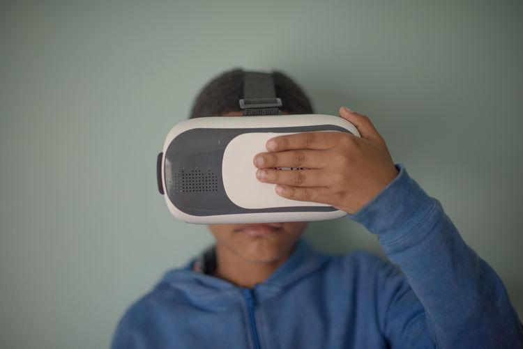 Close-up of boy using virtual reality simulator