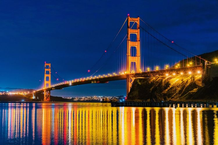 Bridge Water Bridge - Man Made Structure Connection Built Structure Suspension Bridge Transportation Illuminated Sky Architecture Travel Destinations Engineering Waterfront River Reflection Nature Tourism Night Bay Outdoors