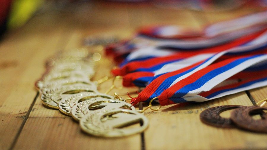 Close-up of medals on wooden table