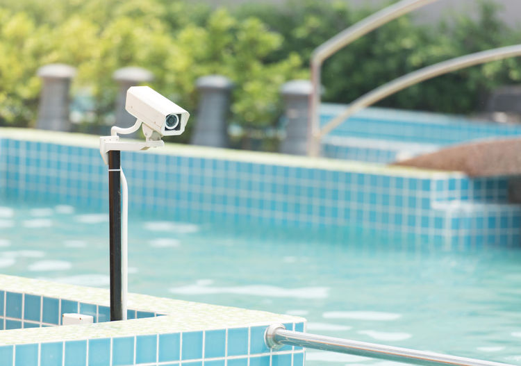 Close-Up Of Security Camera By Swimming Pool