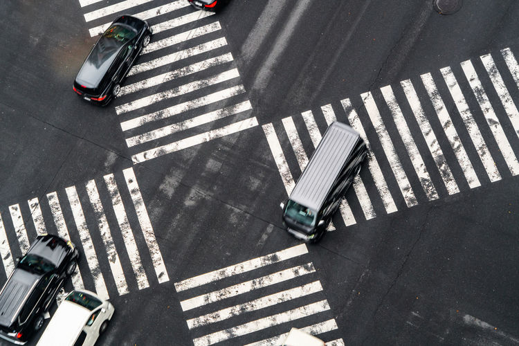 High angle view of cars crossing on road