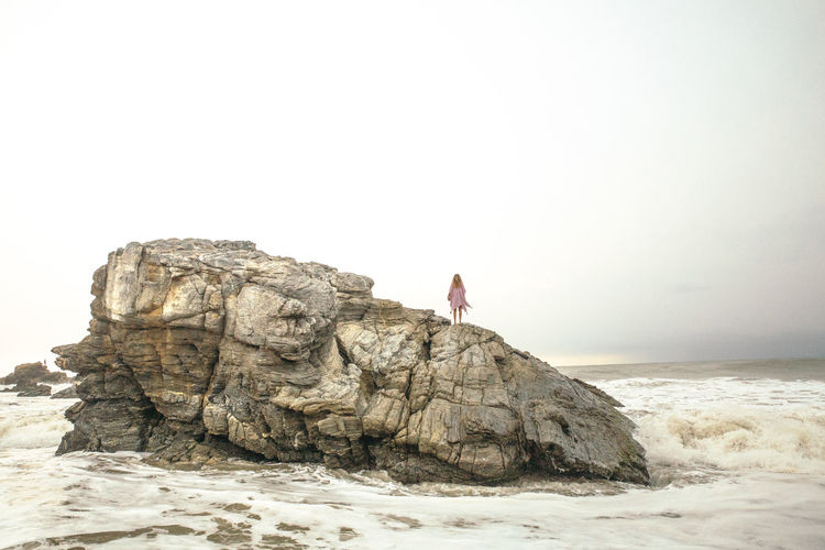 Beach Beauty In Nature Clear Sky Copy Space Horizon Over Water Land Leisure Activity Nature One Person Outdoors Real People Rock Rock - Object Rock Formation Scenics - Nature Sea Sky Solid Water