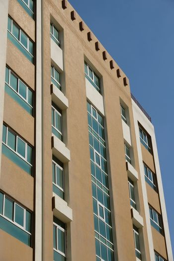 Apartment Doha Apartment Real Estate Building Exterior Built Structure Architecture Low Angle View Building Window Sky Clear Sky No People Day City Nature Residential District Sunlight In A Row Outdoors Blue Conformity Repetition Office