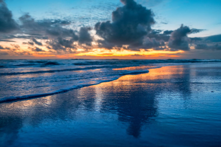 Sky Water Cloud - Sky Sea Reflection Beauty In Nature Scenics - Nature Orange Color Tranquility Nature Tranquil Scene Beach No People Land Outdoors Horizon Dramatic Sky Idyllic Horizon Over Water Atlantic Ocean Sunrise Romance Copy Space Dreaming Glowing