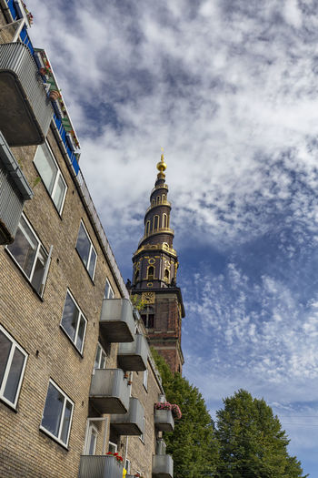 Portrait view of the spire at the Church of our Savior in Copenhagen, Denmark. Architecture Denmark Scandinavia Statue Swimming Tourist Attraction Canal Church Of Our Saviour Copenhagen Danish Destination Historical History Landscape Nyhavn Outdoors Red Fort Relax Rundetaarn Spire  Summer Swim Tourism Traditional