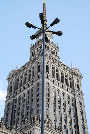 Low Angle View Of Street Light And Palace Of Culture And Science Against Clear Sky